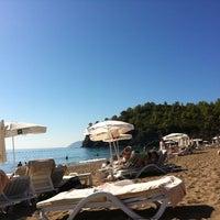 Photo taken at Amara Dolce Vita Beach by Olga on 10/9/2013