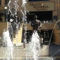 Photo taken at Nelson Mandela Square by Aptraveler on 5/26/2013