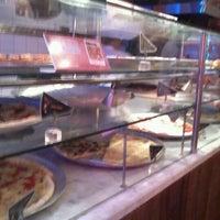 Foto tirada no(a) O Pedaço da Pizza por toniolo n. em 11/23/2012