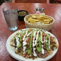 Photo taken at Mango's Taqueria and Cantina by Hossam A. on 7/13/2013