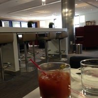 Photo taken at Delta Sky Club by Richard A. on 12/9/2012