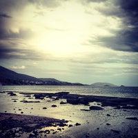 Photo taken at Saronida Beach by Charis T. on 4/14/2013