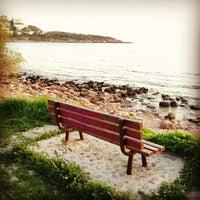 Photo taken at Saronida Beach by Charis T. on 3/11/2013