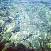 Photo taken at Saronida Beach by Charis T. on 7/16/2013