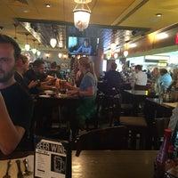 Photo taken at Tigín Irish Pub & Restaurant by Carolina H. on 5/27/2016