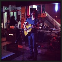 Photo taken at Woodstock Bar & Grill by Jarinee L. on 2/22/2013