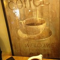 Photo taken at Coffee Tour by Kitty J. on 4/7/2013