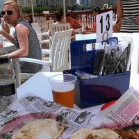Photo taken at Oak Street Beach Food + Drink by Aaron B. on 6/17/2013