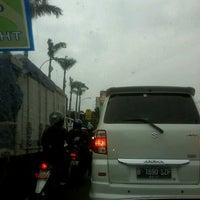 Photo taken at Lampu Merah Cawang by Afrina R. on 12/30/2013