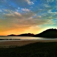 Photo taken at Praia Brava by Marlon M. on 5/30/2013