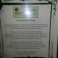 Photo taken at Mulligan's Irish Pub by Tracy B. on 6/26/2013