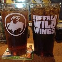 Photo taken at Buffalo Wild Wings by Sande F. on 1/8/2014