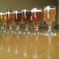 Photo taken at Cascade Brewing Barrel House by C B. on 11/11/2011