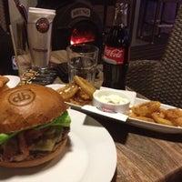 Photo taken at Domyno Burger Bar by Pavel C. on 12/14/2012