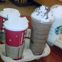 Photo taken at Starbucks by Erwie D. on 12/14/2012