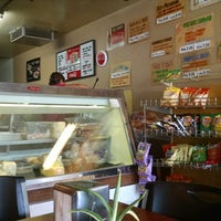 Photo taken at Hungry Hank's Deli by Marcos V. on 8/20/2014