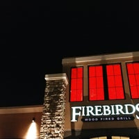 Photo taken at Firebirds Wood Fired Grill by Stelios S. on 1/22/2017