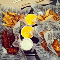 Photo taken at Wingstop by Derek W. on 3/23/2014