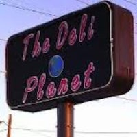 Photo taken at Deli Planet by Rebecca F. on 3/1/2014