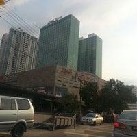 Photo taken at KSL City Mall by ekino on 4/12/2013