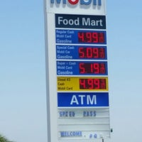 Photo taken at Mobil by JEAN CARLOS on 7/11/2014