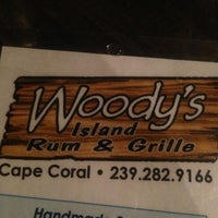 Photo taken at Woody's Surfside Island Rum & Grille by Cedric S. on 4/5/2013