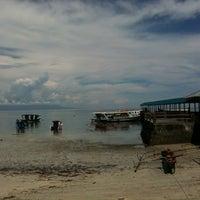 Photo taken at Bunaken Star Boys Snorkling & Diving by Budiman D. on 6/10/2013