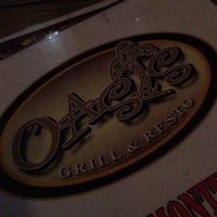 Photo taken at Oasis Bar and Grill by Ruth Ann B. on 12/12/2012