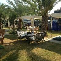 Photo taken at Yeşim Beach & Restaurant by Emre S. on 8/12/2013