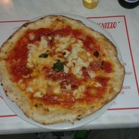 Photo taken at Ristorante Pizzeria 'O Scugnizzo by Giorgio M. on 8/4/2014