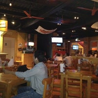 Photo taken at Hooters by Andres V. on 11/17/2012