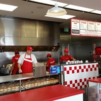 Photo taken at Five Guys by Andrew G. on 9/1/2014