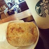 Photo taken at Starbucks by YUiKO on 12/26/2012