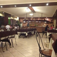 Photo taken at Rustica Restaurant by Kimberly A. on 1/30/2013