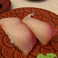 Photo taken at 回転寿司 大漁丸 by makoto s. on 12/9/2012