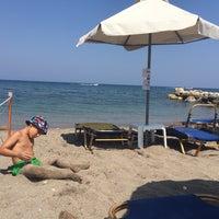 Photo taken at Kolymbia Beach by Inga I. on 8/6/2015