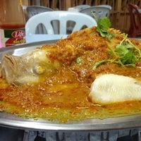Photo taken at Lucky Steam Fish Restaurant by Queenie L. on 12/28/2012