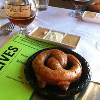Photo taken at Olives Gourmet Grocer by Esther J. on 7/25/2013