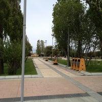 Photo taken at Plaza de Armas de Puerto Natales by Elizabeth on 11/23/2012