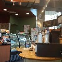 Photo taken at Starbucks by Huseyin B. on 5/12/2013