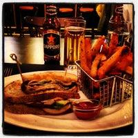 Photo taken at Delmonico's Kitchen by Laura R. on 12/5/2012