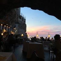 Photo taken at Grotta Palazzese by Marjolein K. on 5/24/2017