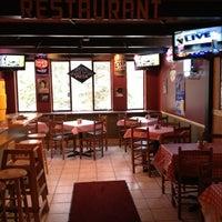 Photo taken at New York Pizza by Elizabeth I. on 11/16/2012