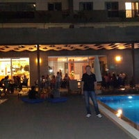 Photo taken at Elite Club Cafe by Murat A. on 8/8/2014