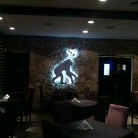 Photo taken at Parapithecus Evolution Bar by Juan Pablo C. on 11/28/2012