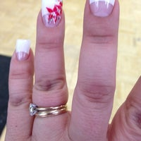 Photo taken at Fancy Nails by Maria C. on 2/16/2013