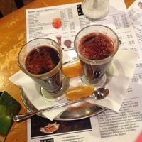 Photo taken at PopoCafePetl Café/Bar by Nastya K. on 3/21/2013