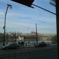 Photo taken at Café Slavia by Maria S. on 12/2/2012
