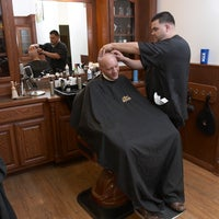 Das Foto wurde bei Roosters Men's Grooming Center von Roosters Men's Grooming Center am 7/4/2014 aufgenommen