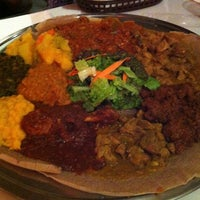 Photo taken at New Eritrea Restaurant & Bar by Hannah L. on 3/25/2013
